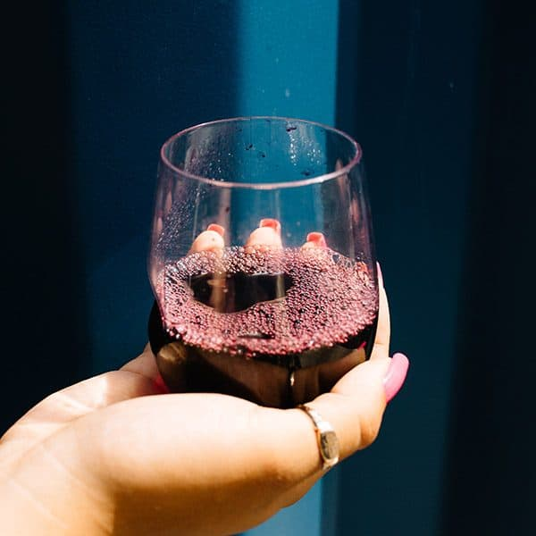 Glass of More Wine red wine