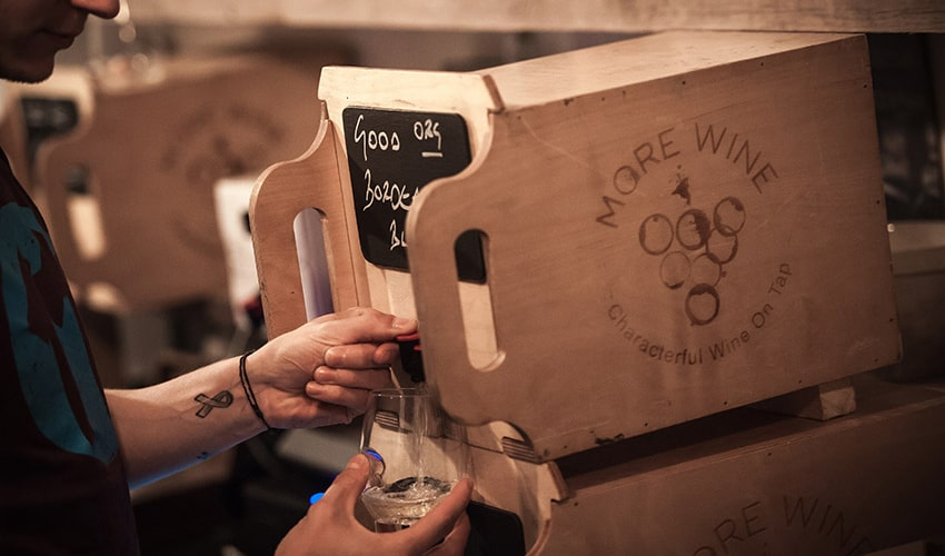 Why we should drink more wine on tap - Artilce image - pouring glass of wine from wine box